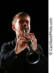 Clarinet player - The teenager playing on a clarinet. The...