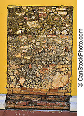 Breaks on the yellow wall - antique brickwork