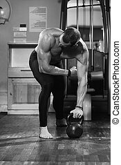 Man And Kettle Bell - Athletic Man Workout With Kettle Bell