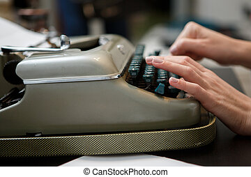 typewriter woman hands - closeup of woman typing with old...