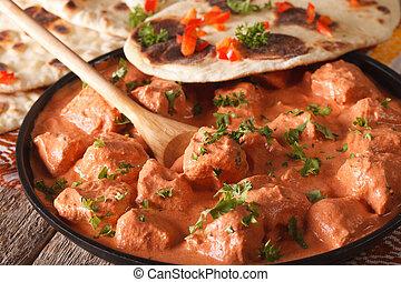 Indian food chicken tikka masala and naan close-up....