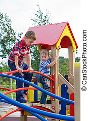 playground - The boys climb on the equipment of a playground