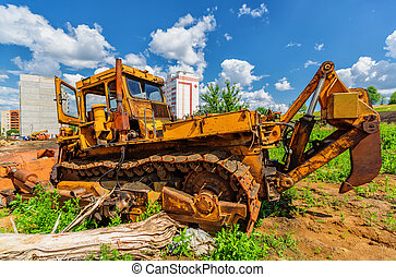 Bulldozer on construction site beneath cloudy sky - View of...