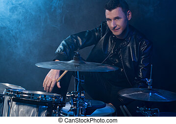 Young man with drums