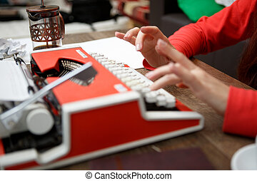 woman at table typing on typewriter - woman at table typing...
