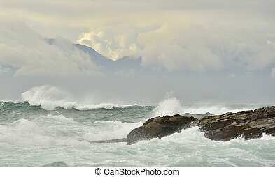 Sea landscape. An morning, Clouds sky and mountains. False...