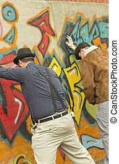 Urinating in Public - Two stylish men urinating in public...