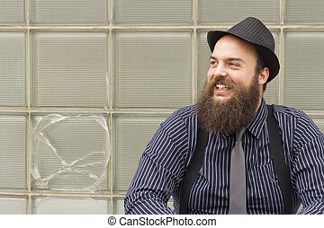Snazzy Bearded Man - Stylish bearded man laughs with delight...