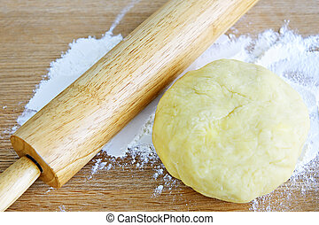 Rolling pin and cookie dough - Wooden rolling pin and ball...