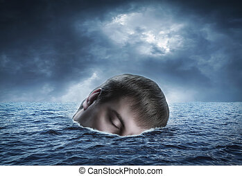 Human head in the sea - Drifting on the waves in the sea...