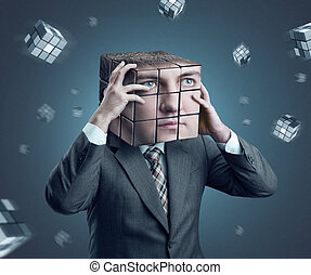 Businessman with rubik cube head - Businessman holding his...