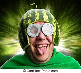 Funny man with watermelon helmet and googles looks like a...