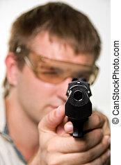 Aiming gunman in bulletproof glasses