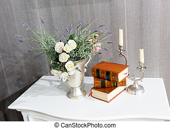 Flowers with books - Flowers, books and a candlestick on the...