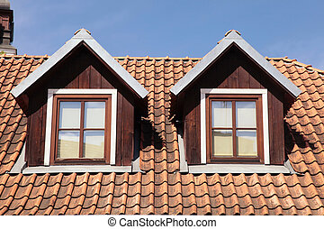 tiled roof and garret windows in old house - orange tiled...