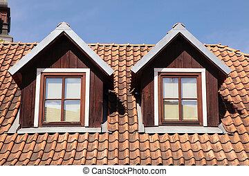 tiled roof and garret windows in old house - orange tiled...