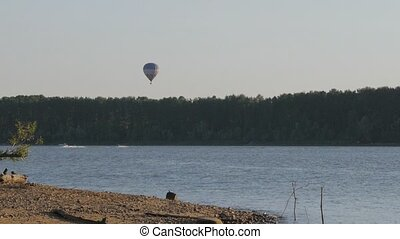 Hot Air Balloon above lake