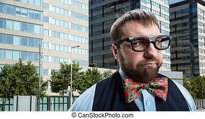 Strange nerd - Nerd businessman in glasses against city...