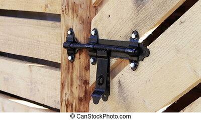 Lock shutter in the wooden door.