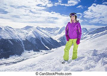 Young woman on a mountain ski resort