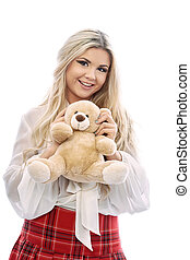 Beautiful blonde plays with Teddy bearThe girl wears a...
