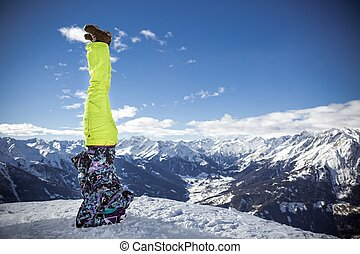Sporty girl feeling happy in elbowstand at high mountains -...