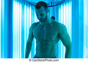 Man In Solarium - Young Muscular Man At Solarium In Beauty...