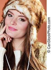 Girl in fur cap - Portrait of fashionable pretty woman in...
