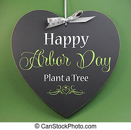 Happy Arbor Day greeting message sign on heart shaped...