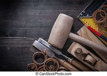 Set of joiner tools on wooden board construction concept
