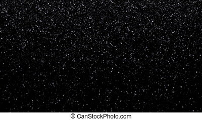 Very small snow flakes falling on black background, loopable