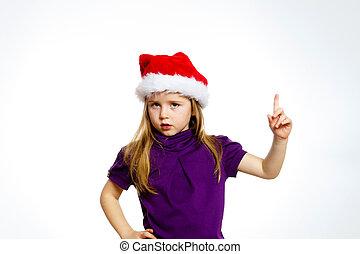 Cute little girl in santa red hat s