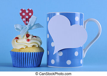 Fancy blue theme cupcake with red and white decorations with...