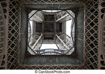 Low angle view of Eiffel Tower in Paris seen from inside...