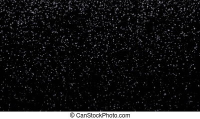 Small snow flakes falling on black background, loopable