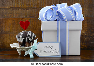 Happy Fathers Concept with blue and white gift and cupcake.
