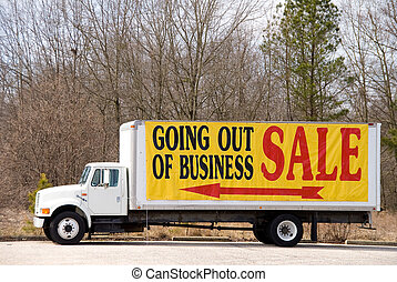 Going Out of Business - A truck advertising a store that is...