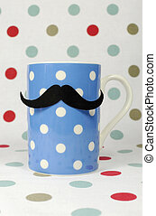 Morning mustache on a blue coffee mug against a polka dot...
