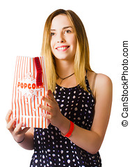 Person at movie cinema with popcorn bag - Isolated photo of...