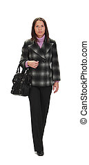 Woman walking - Casually dressed woman with a bag,...