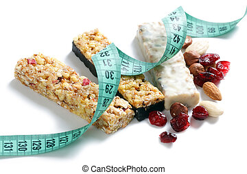 muesli bars with measuring tape on white background