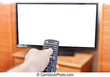 Hand switches TV channels with cut out screen - Hand...