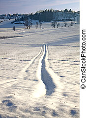 Snowscape - Landscape of a hill with a snow-covered track
