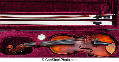 old fiddle with bow in red velvet case