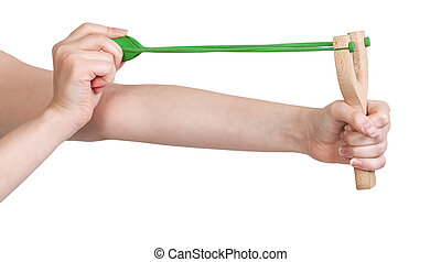 hands pull rubber band of slingshot isolated
