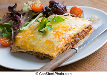 Beef lasagne with vegetable salad