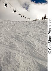 Under the Chair - Fresh, soft snow and ski tracks under a...