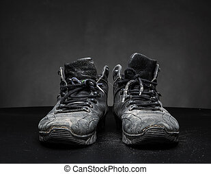Old worn out shoes - Old black worn out work shoes on the...
