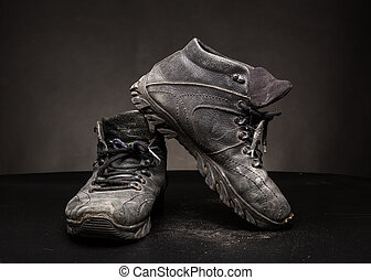 Old worn out shoes - A pair of old black worn out shoes on...