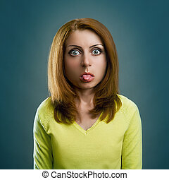 Woman is sticking out her tongue - Woman girl with big head...